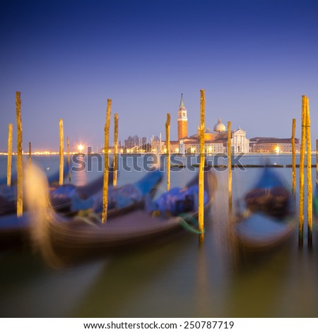 beautiful Venice, Italy with gondolas -colored photo, with added vignetting, long exposure - stock photo