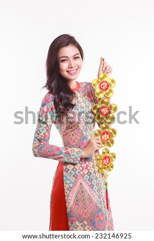 Beautiful Vietnamese woman wearing impression ao dai holding lucky decorate object for celebrate lunar new year on white background - stock photo