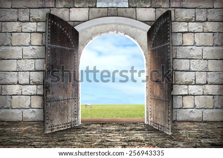 Beautiful view from arched passage.  Opening to a beautiful cloudy sky - stock photo