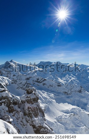 Beautiful view from the Swiss mountain Titlis towards the South. On the horizon from left to right you can see the mountains Sustenhorn, Dammastock, Tierberge and Diechterhorn. - stock photo