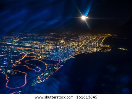 Beautiful view from the the plane on night Dubai. United Arab Emirates - stock photo