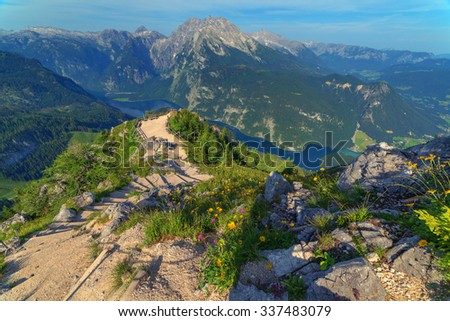 Beautiful view from top of cableway above the Konigsee lake on Schneibstein mountain ridge. Border of German and Austrian Alps, Europe. - stock photo