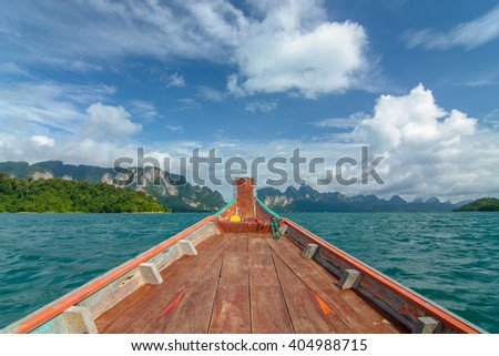 beautiful view mountain lake and river from long tail boat in Ratchaprapa dam , Khoa sok national park , Surat thani ,Thailand(Un-focus image) - stock photo