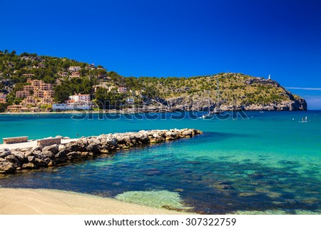 beautiful view of a harbour with small mole made of stones at the Port de Soller, Majorca, Spain - stock photo