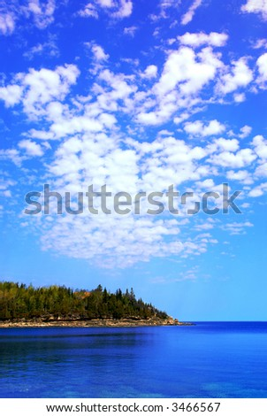 Beautiful view of a scenic lake with clear water and spectacular sky. Georgian Bay, Canada. - stock photo