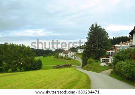 Beautiful view of a small village in Alpine Austria, cloudy and dull weather  - stock photo