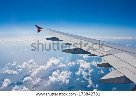 Beautiful view of  airplane wing on blue sky background - stock photo