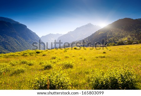 Beautiful view of alpine meadows in the village Zhabeshi. Upper Svaneti, Georgia, Europe. Caucasus mountains. Beauty world. - stock photo