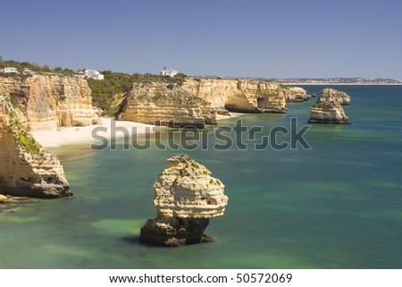 Beautiful view of an idyllic wild beach in summertime - Marinha beach at Algarve, Portugal. - stock photo
