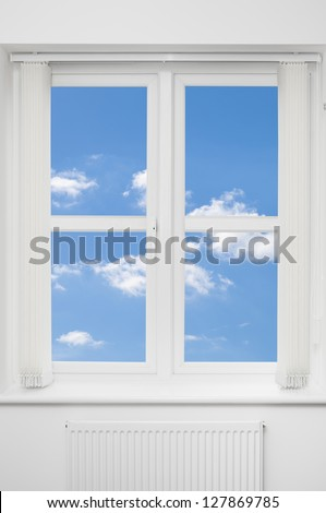 Beautiful view of blue summer sky through a white window - stock photo