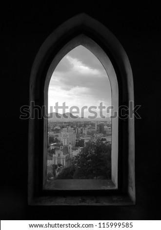 Beautiful view of Capital City Ljubljana in Slovenia through a Castle window - stock photo