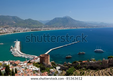 Beautiful view of city Alanya in Turkey. Red tower and harbor - stock photo