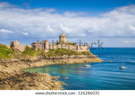 Beautiful view of famous ancient Fort-La-Latte castle on the Cote d'Emeraude on a sunny day with blue sky and clouds in summer, commune of Frehel, Cotes-d'Armor, Brittany, France