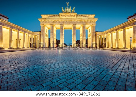 Beautiful view of famous Brandenburger Tor (Brandenburg Gate), one of the best-known landmarks and national symbols of Germany, in twilight during blue hour at dawn, Berlin, Germany