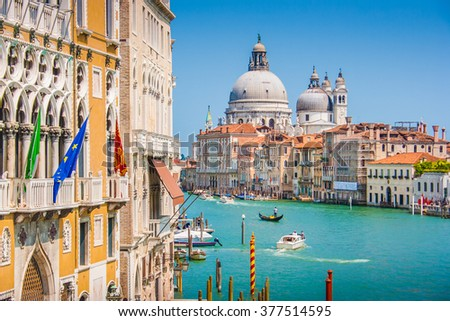 Beautiful view of famous Canal Grande with historic Basilica di Santa Maria della Salute in the background on a sunny day with blue sky in summer, Venice, Italy - stock photo