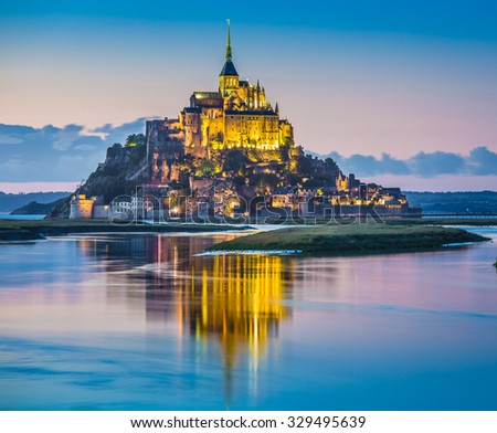Beautiful view of famous Le Mont Saint-Michel tidal island in beautiful twilight during blue hour at dusk, Normandy, northern France - stock photo