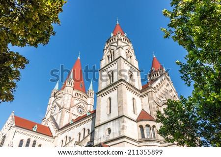 Beautiful view of famous neo-romane designed St. Francis of Assisi Church (Kirche zum heiligen Franz von Assisi) under blue sky -Vienna,Austria - stock photo
