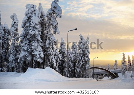 Beautiful view of finnish landscape with trees in snow, pyha, karelia, lapland, hilly winter landscapes in famous winter sports area called Pyha - stock photo