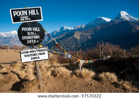 Beautiful view of grass field and Himalayan mountains in morning when see from the top of Poonhill peak, Nepal - stock photo
