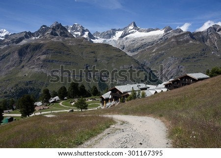 Beautiful view of idyllic summer landscape in the Alps with Gornergrat glacier and highest swiss peaks Nordend and Dufourspitze