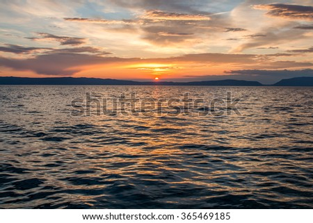 Beautiful view of magic sunset over sea  - stock photo