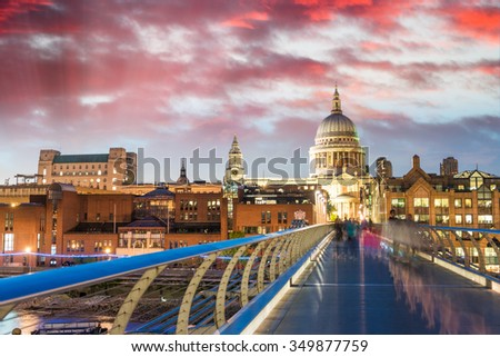 Beautiful view of Millennium Bridge and St Paul Cathedral at dusk - London. - stock photo