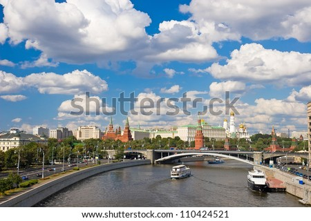Beautiful view of Moscow river and Kremlin during sunny, cloudy day - stock photo
