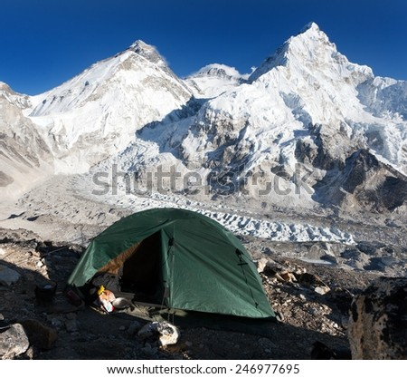 Beautiful view of mount Everest, Lhotse and nuptse from Pumo Ri base camp with green tent - way to Everest base camp - Nepal - stock photo