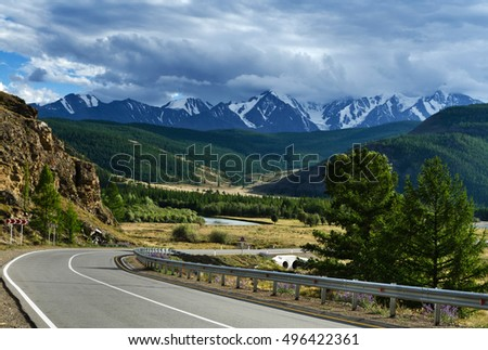Beautiful view of mountain road in summer evening. Altai Mountains, Russia