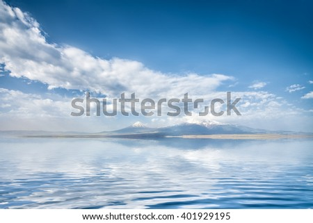 Beautiful view of mountains with sunny sea and cloudy blue sky. Exploring Armenia