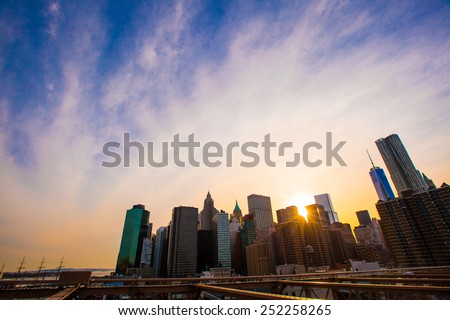 Beautiful view of New York from Brooklyn Bridge at sunset