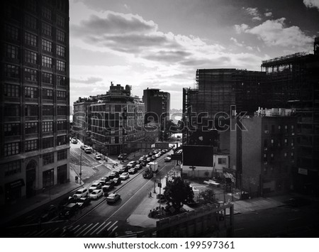 Beautiful view of NYC traffic and buildings at rush hour. Instagram black and white effect filter used. - stock photo
