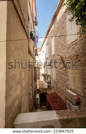 Beautiful view of old narrow street at city of Budva, Montenegro - stock photo