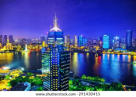 Beautiful view of  Shanghai -  Bund or Waitan waterfront at night. Shanghai waterfront Bund has historical buildings and it is one of the most famous tourist places in Shanghai. - stock photo