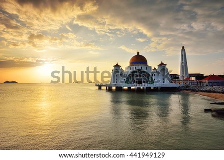 Beautiful view of Straits Mosque, Malacca Malaysia during sunset. Soft focus due to long exposure shot. Vibrant colors and nature composition.