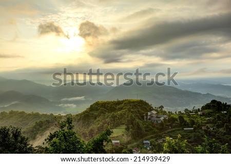 Beautiful view of sunrays on the mountain of pokhara - stock photo