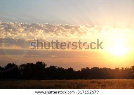 Beautiful view of sunset sky over countryside - stock photo