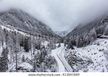 Beautiful view of swiss alps in winter on the famous sightseeing train glacier express, Switzerland. - stock photo