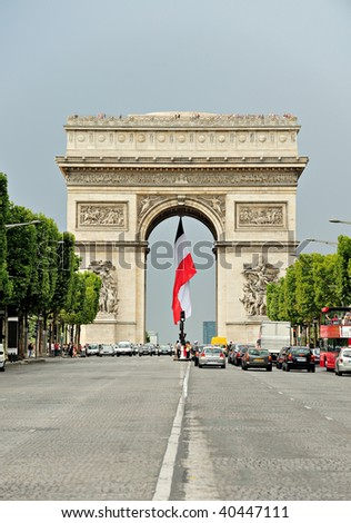 Beautiful  view of the Arc de Triomphe with flag, Paris - stock photo