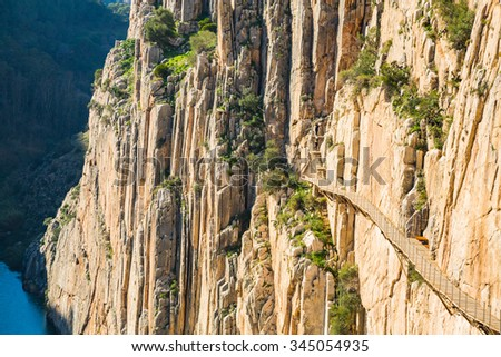 Beautiful view of the Caminito Del Rey mountain path along steep cliffs - stock photo