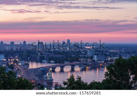 Beautiful view of the Dnieper river and bridge in Kyiv (Ukraine) at sunset - stock photo