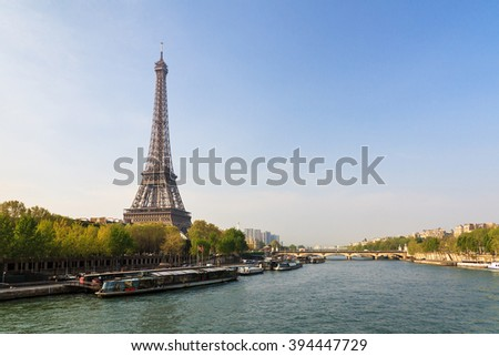 Beautiful view of the Eiffel tower from the Passerelle Debilly bridge in Paris in spring - stock photo