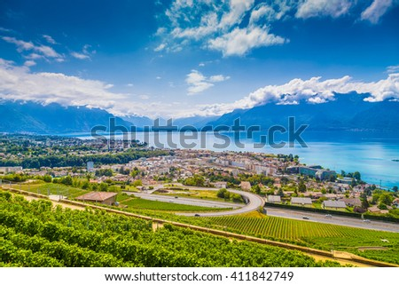 Beautiful view of the famous city of Vevey with rows of vineyard terraces in famous Lavaux wine region, overlooking the northern shores of Lake Geneva near Lausanne, Canton of Vaud, Switzerland - stock photo