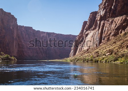 beautiful view of the Glen Canyon from the colorado river with huge colorful sandstone cliffs - stock photo