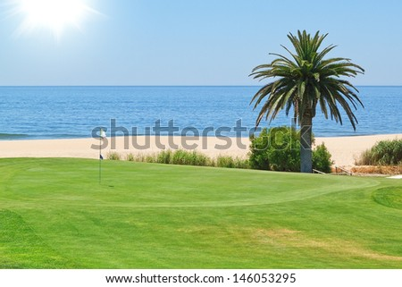 Beautiful view of the golf course to the sea and palm trees. Portugal, Algarve. - stock photo