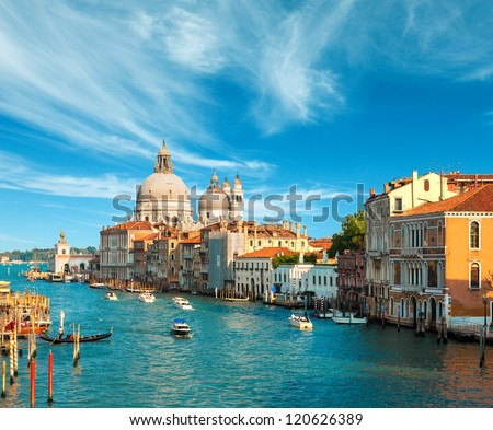 Beautiful view of the Grand Canal and Basilica Santa Maria della Salute in the late evening with very interesting clouds, Venice, Italy - stock photo