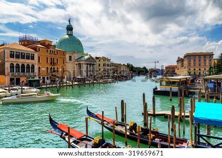 Beautiful view of the Grand Canal with gondolas and the San Simeone Piccolo (San Simeone e Giuda) in Venice, Italy. Venice is a popular tourist destination of Europe. - stock photo