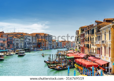 Beautiful view of the Grand Canal with gondolas from the Rialto Bridge (Ponte di Rialto) in Venice, Italy. Venice is a popular tourist destination of Europe. - stock photo