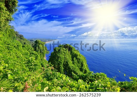 Beautiful view of the green island, sea and blue sky - stock photo