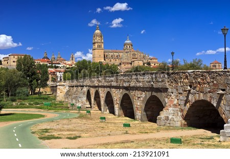Beautiful view of the historic city of Salamanca with New Cathedral and Roman bridge, Castilla y Leon region, Spain  - stock photo